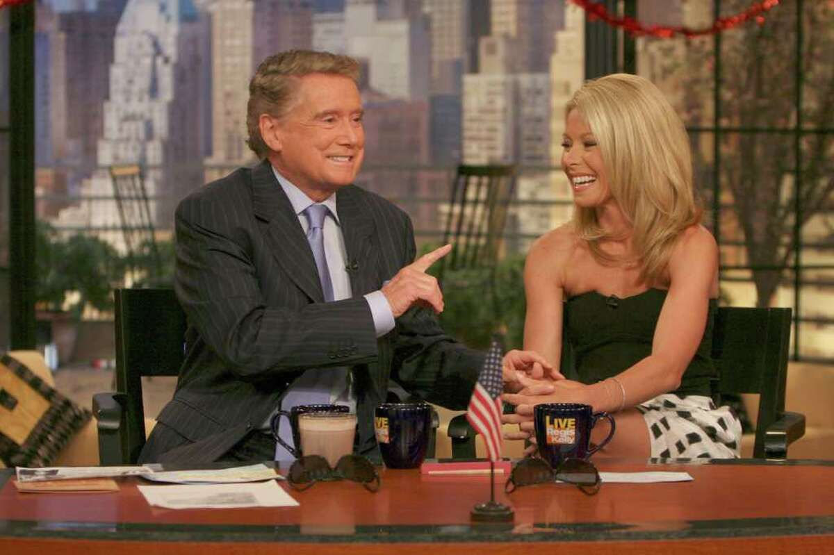 """This photo supplied by Buena Vista Television shows host Regis Philbin, on his first day back on the """"Live with Regis and Kelly"""" television show, following heart bypass surgery, talking with co-host Kelly Ripa, on the show on April 26, 2007, in New York. (AP Photo/Buena Vista Television)"""