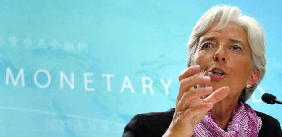 New International Monetary Fund (IMF)  Managing Director Christine Lagarde gestures during her first news conference at the IMF in Washington, Wednesday, July 6, 2011. (AP Photo/Susan Walsh) Photo: Susan Walsh, STF / AP