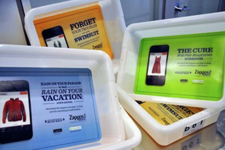 Credit: Houston Airport System Advertising now appears in the small trays used in security screening of travelers? personal items at Houston?s airports. Photo: Houston Airport System