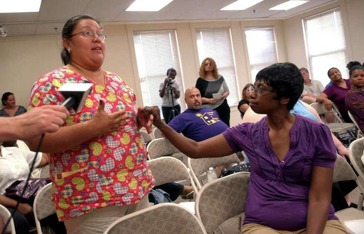 Parent Zoila Vagconez, left, expresses her concerns for the education system in Bridgeport as Carol Nunley holds her hand, during a meeting of Connecticut Parents Union at the Burroughs Community Center in Bridgeport, on Wednesday July 6, 2011.