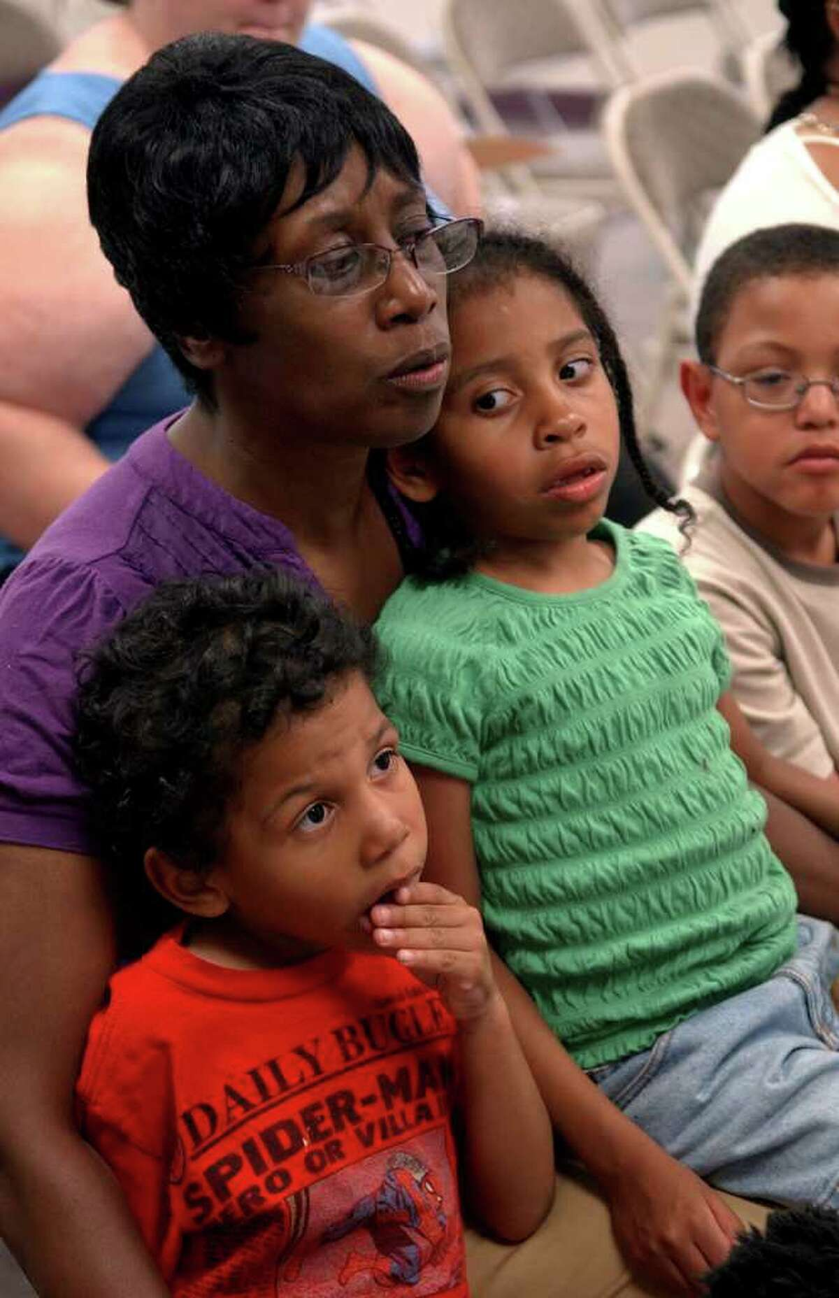 Carol Nunley sits with her grandchildren Andreas Garcia, 3, and Arin, 5, during a meeting of Connecticut Parents Union at the Burroughs Community Center in Bridgeport, on Wednesday July 6, 2011.