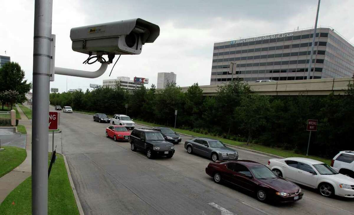 Red-light camera at the intersection of the 610 West Loop South feeder and Westheimer Rd. Wednesday, July 6, 2011. ( Melissa Phillip / Houston Chronicle )