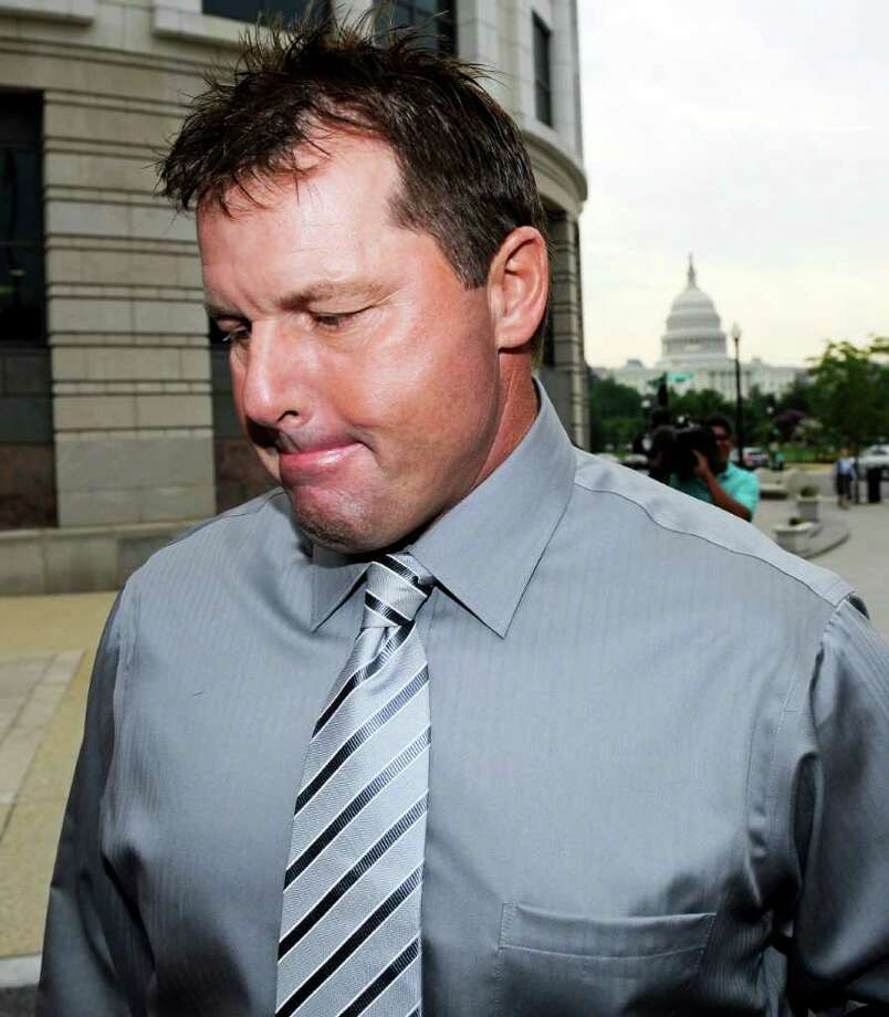 With the Capitol in the background, former Major League Baseball pitcher Roger Clemens arrives at federal court in Washington, Wednesday, July 6, 2011, for his trial on charges of lying to Congress in 2008 when he denied ever using performance-enhancing drugs during his 23-year career.  (AP Photo/Cliff Owen) Photo: Cliff Owen, FRE / FR170079 AP