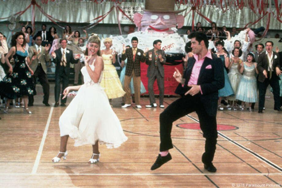 "(L-R) Olivia Newton-John as Sandy and John Travolta as Danny in ""Grease Sing-Along."""