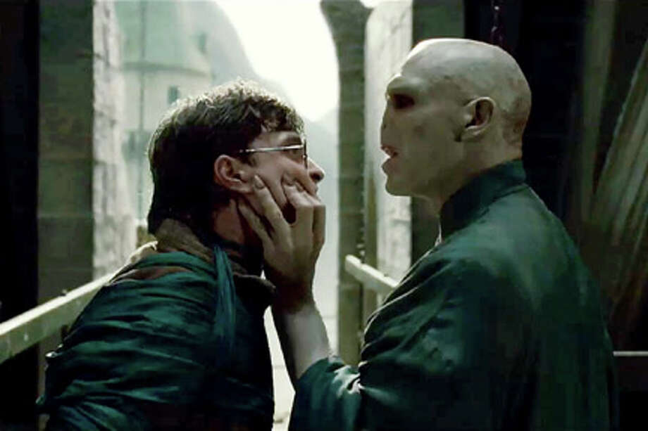 "(L-R) Daniel Radcliffe as Harry Potter and Ralph Fiennes as Lord Voldemort in ""Harry Potter and the Deathly Hollows: Part 2."" Photo: Courtesy Of Warner Bros Pictures / © 2011 Warner Bros Entertainment Inc."