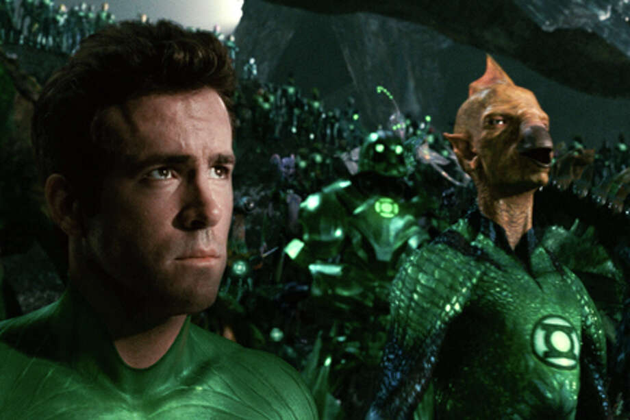 "(L-R) Ryan Reynolds as Green Lantern and Tomar-Re in ""Green Lantern."" Photo: Photo Courtesy Of Warner Bros. Pictures, Courtsey Of Warner Bros. Entertainment / © 2011 Warner Bros. Entertainment Inc. TM & © DC Comics - All Rights Reserved"