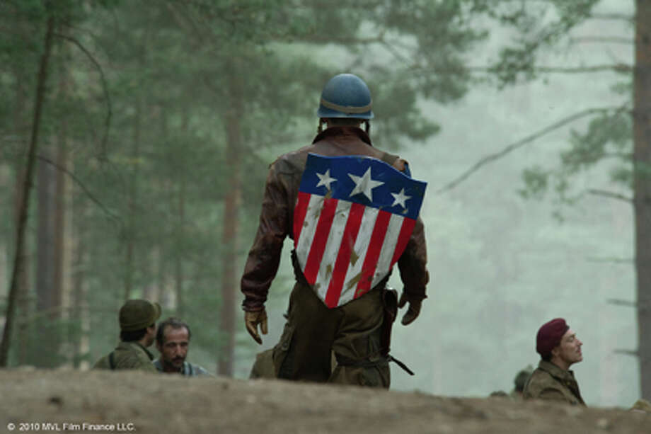 "(Center) Chris Evans as Steve Rogers in ""Captain America: The First Avenger."" Photo: Photo Credit: Jay Maidment, Jay Maidment / Captain America: The First Avenger, the Movie: ©  2010 MVL Film Finance LLC.  Marvel, Captain America, all character names and t"