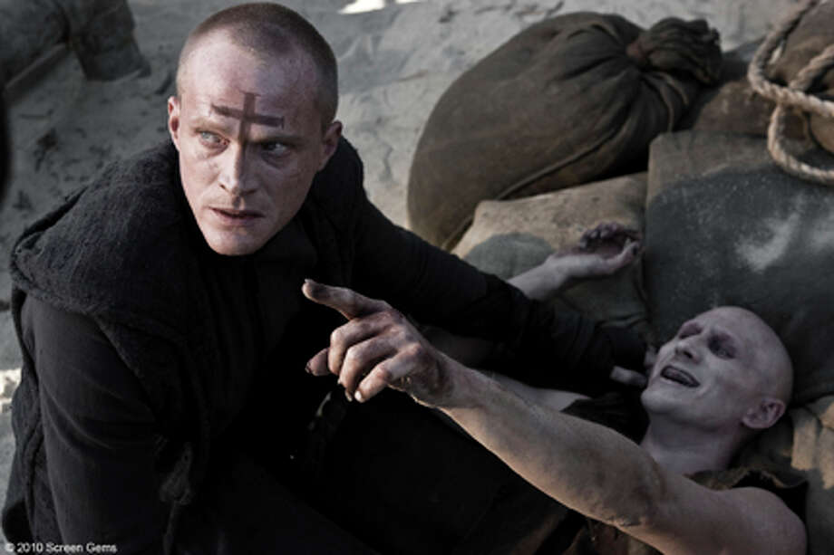 "(Left) Paul Bettany as Priest in ""Priest."" Photo: Scott Garfield / © 2010 Screen Gems, Inc.  All Rights Reserved. **ALL IMAGES ARE PROPERTY OF SONY PICTURES ENTERTAINMENT INC. FOR PROMOTIONAL USE"