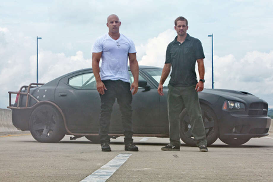 "(L-R) Vin Diesel as Dominic Toretto and Paul Walker as Brian O'Conner in ""Fast Five."" Photo: Jaimie Trueblood / 2011 Universal Studios"