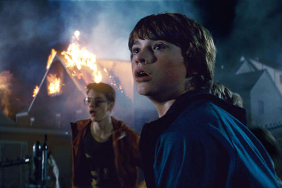 "Joel Courtney (right) as Joe Lamb in ""Super 8."""