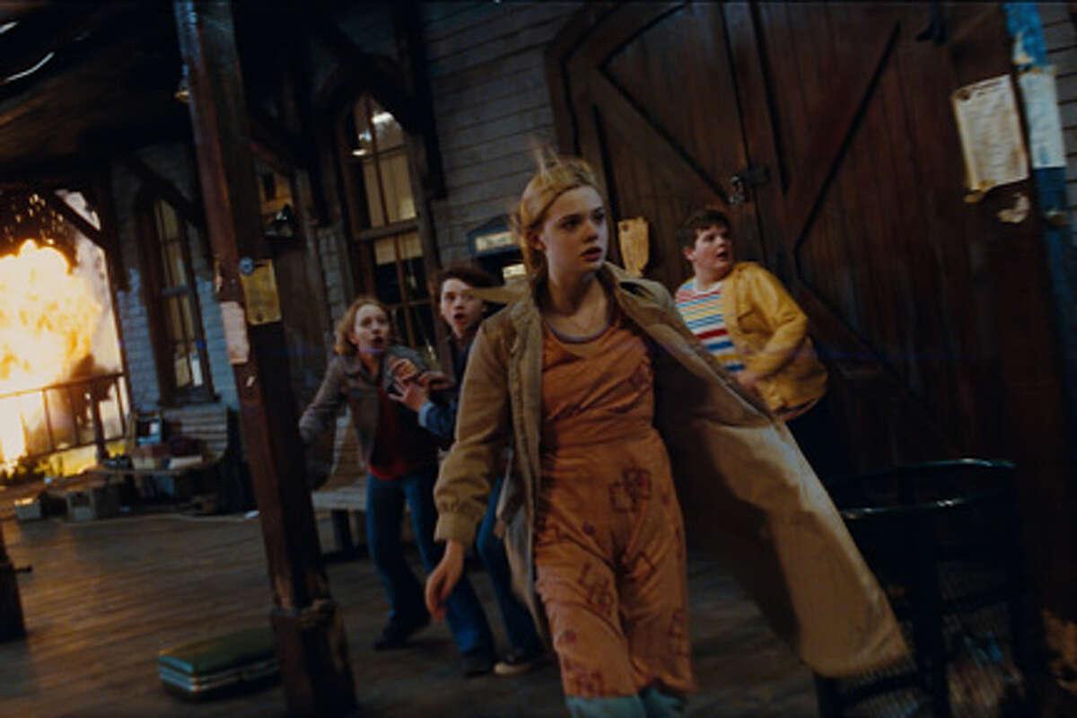 Elle Fanning (center) as Alice in