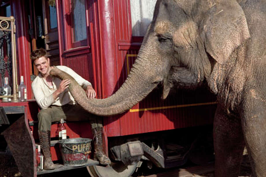 "Robert Pattinson as Jacob and Rosie the elephant in ""Water for Elephants."" Photo: David James / TM and © 2011 Twentieth Century Fox Film Corporation.  All rights reserved.  Not for sale or duplication."