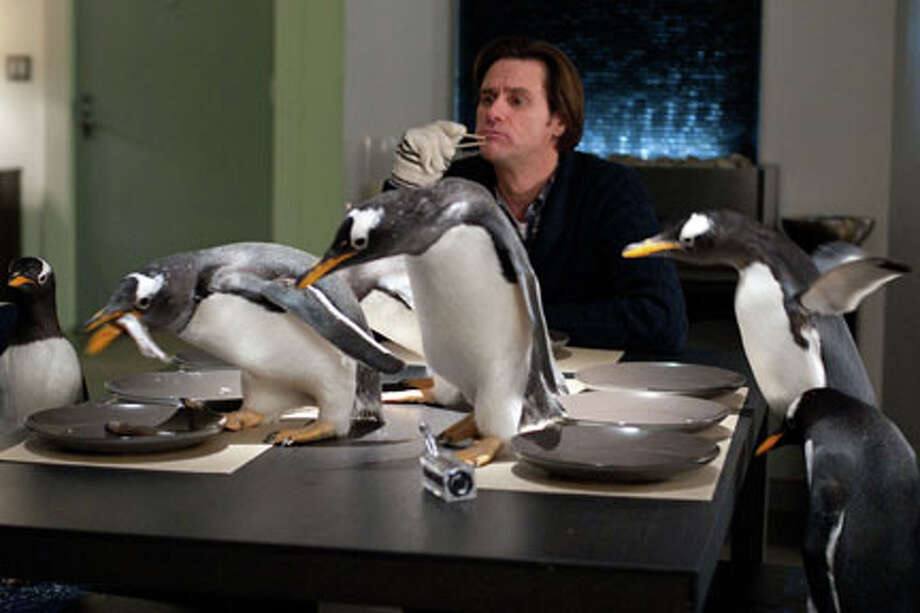 "Jim Carrey as Tom Popper in ""Mr. Popper's Penguins."" Photo: Photo Credit: Barry Wetcher"