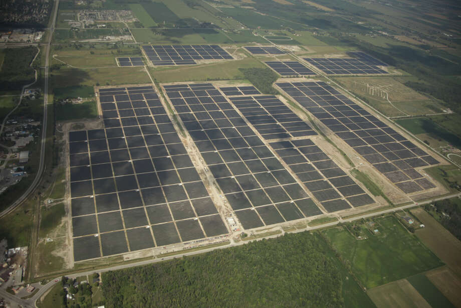 This is a view of the Sarnia Solar Project in Ontario. At 97 megawatts, it's currently the world's largest solar farm. CPS Energy has revised plans for its next project to make it 400 megawatts instead of the original 50-megawatt facility envisioned. Photo: Courtesy Photo