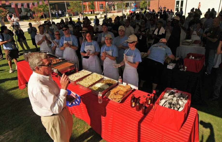 Haven for Hope and NuStar chairman Bill Greehey (left) speaks to volunteers and residents of Haven for Hope at the start of a barbecue on Wednesday, July 6, 2011, celebrating the one-year anniversary of the downtown campus for the homeless. NuStar Energy sponsored the barbecue. Photo: Robin Jerstad/Special To The Express-News