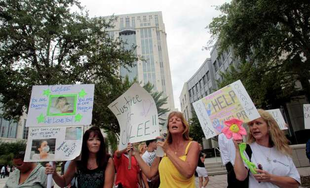 People dissatisfied with the the Casey Anthony verdict protest outside the Orange County Courthouse in Orlando, Fla., Thursday, July 7 2011.  Casey Anthony, who was acquitted of killing her daughter, Caylee Anthony, faces sentencing for lesser charges today. Photo: AP