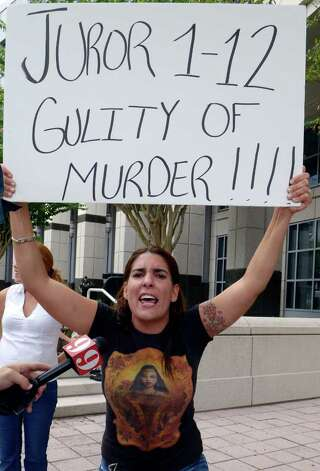 Michelle Caballero, of Miami, protests the Casey Anthony verdict outside the Orange County Courthouse in Orlando, Fla., Thursday, July 7, 2011.  Judge Belvin Perry sentenced  Anthony to four years for lying to investigators but says she can go free in late July or early August because she has already served nearly three years in jail and has had good behavior. While acquitted of killing and abusing her 2-year-old daughter Caylee, Anthony was convicted of four counts of lying to detectives trying to find her daughter in July 2008. Photo: AP