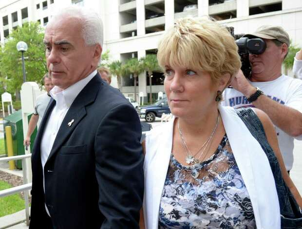 George Anthony, left, and Cindy Anthony, parents of Casey Anthony, arrive at the Orange County Courthouse for Casey Anthony's sentencing in Orlando, Fla., Thursday, July 7, 2011.  Anthony was acquitted of murder charges. Photo: AP