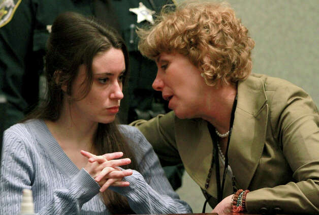 Casey Anthony, left, talks with her attorney, Dorothy Clay Sims, during a sentencing hearing in Orlando, Fla. on Thursday, July 7, 2011. Judge Belvin Perry sentenced Anthony to four years for lying to investigators but says she can go free in late July or early August because she has already served nearly three years in jail and has had good behavior. While acquitted of killing and abusing her 2-year-old daughter Caylee, Anthony was convicted of four counts of lying to detectives trying to find her daughter in July 2008. Photo: AP