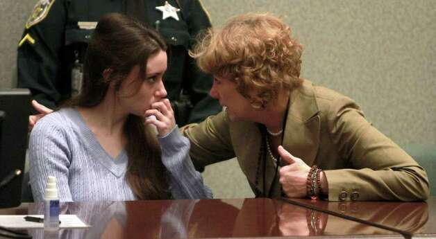 Casey Anthony talks with her attorney, Dorothy Clay Sims, before a sentencing hearing in Orlando, Fla. on Thursday, July 7, 2011. Anthony was acquitted of killing her daughter, Caylee, but faces four charges of lying to police officials. Photo: AP