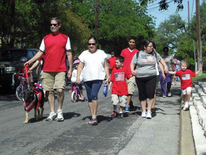 Paradegoers head for Landa Library as part of the Monte Vista Historical Association's Independence Day parade Monday.