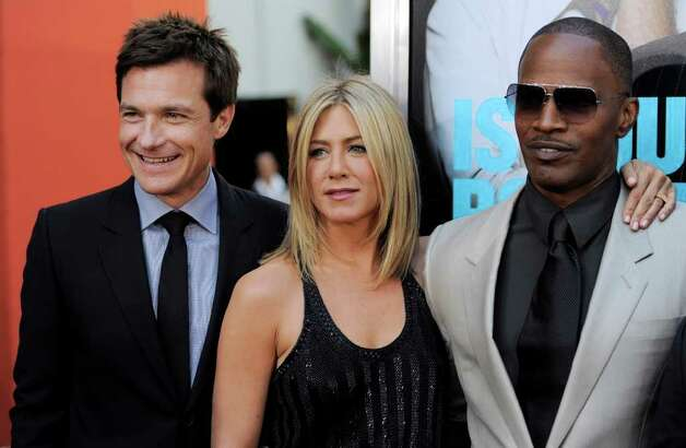 "Jason Bateman, left, Jennifer Aniston, center, and Jamie Foxx, cast members in ""Horrible Bosses,"" pose together at the premiere of the film, Thursday, June 30, 2011, in Los Angeles. The film is released on July 8. Photo: AP"