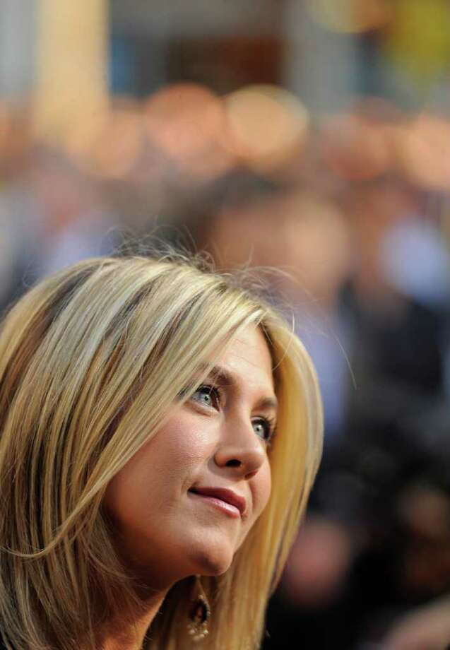 "Jennifer Aniston, a cast member in ""Horrible Bosses,"" listens to a reporter's question at the premiere of the film, Thursday, June 30, 2011, in Los Angeles. The film is release on July 8. Photo: AP"
