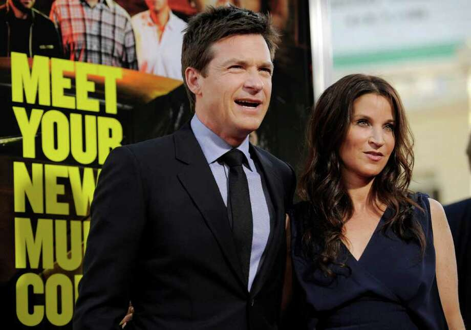 "Jason Bateman, left, a cast member in ""Horrible Bosses,"" and his wife Amanda arrive at the premiere of the film, Thursday, June 30, 2011, in Los Angeles. The film is released on July 8. Photo: AP"