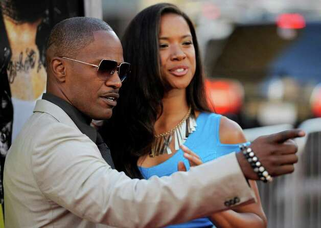"Jamie Foxx, a cast member in ""Horrible Bosses,"" poses with his date Britt Loren at the premiere of the film, Thursday, June 30, 2011, in Los Angeles. The film is released on July 8. Photo: AP"