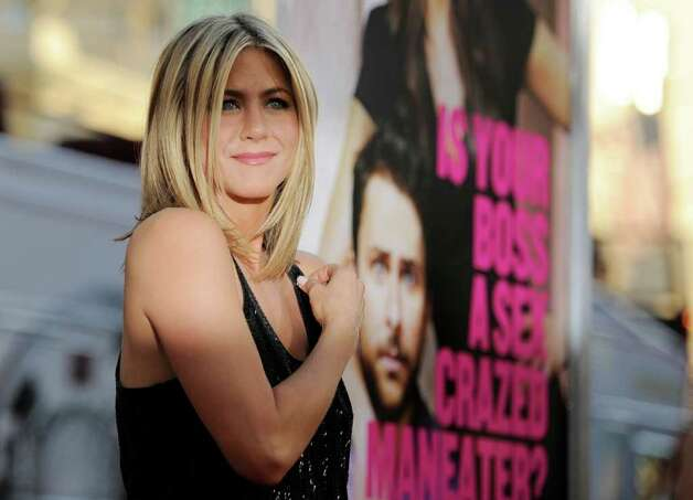 "Jennifer Aniston, a cast member in ""Horrible Bosses,"" poses at the premiere of the film, Thursday, June 30, 2011, in Los Angeles. The film is released on July 8. Photo: AP"