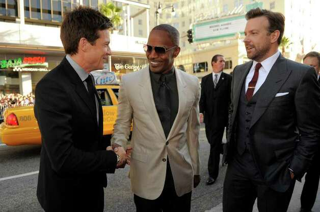 """Horribles Bosses"" cast members, from left, Jason Bateman, Jamie Foxx and Jason Sudeikis mingle at the premiere of the film, Thursday, June 30, 2011, in Los Angeles. The film is released on July 8. Photo: AP"