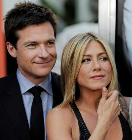"Jason Bateman, left, and Jennifer Aniston, cast members in ""Horrible Bosses,"" pose together at the premiere of the film, Thursday, June 30, 2011, in Los Angeles. The film is released on July 8. Photo: AP"
