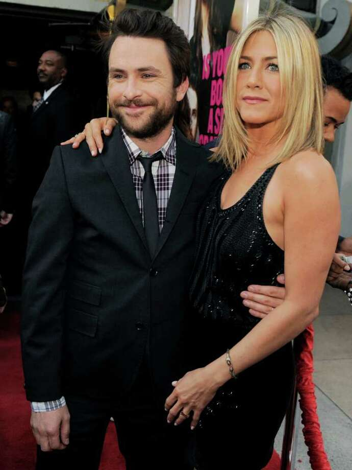 "Charlie Day, left, and Jennifer Aniston, cast members in ""Horrible Bosses,"" pose together at the premiere of the film, Thursday, June 30, 2011, in Los Angeles. The film is released on July 8. Photo: AP"