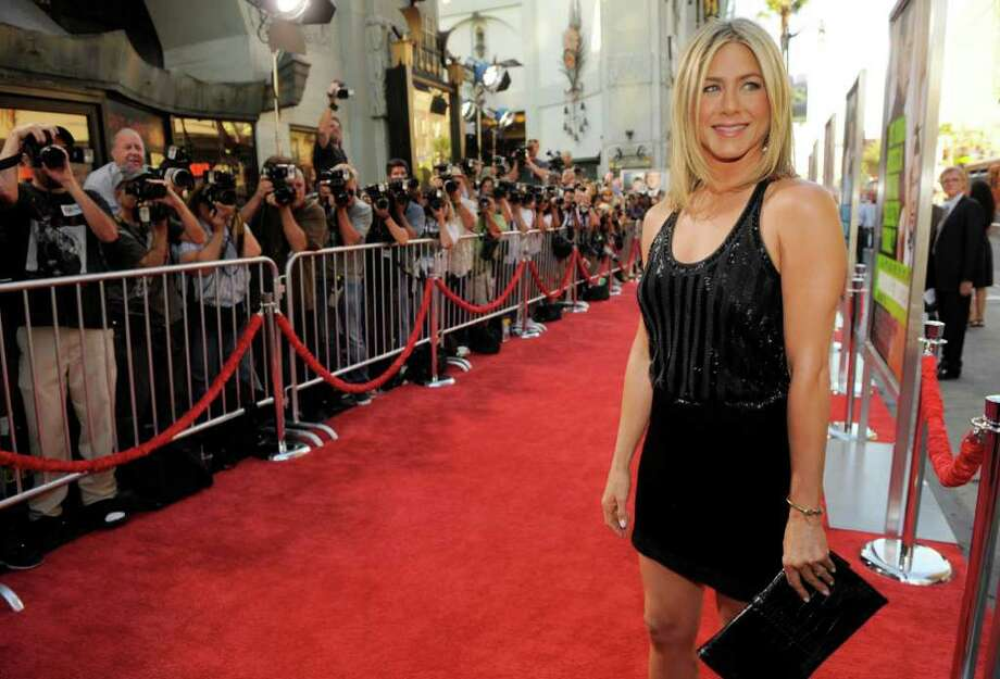 "Jennifer Aniston, a cast member in ""Horrible Bosses,"" poses at the premiere of the film, Thursday, June 30, 2011, in Los Angeles. The movie is set to be in theaters Friday July 8, 2011. Photo: AP"