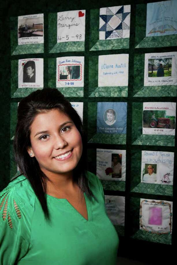FOR LA VOZ: Florencia Quesnel, 20, in front of a quilt assembled from patches created by families of organ donors. She is on a mission to raise awareness in the Hispanic community about organ and tissue donation. Quesnel still needs a liver transplant but after success with other treatments she now wants to help others in greater need of a donor than herself, as seen at the LifeGift headquarters in Thursday, June 9, 2011 in Houston. ( Patrick T. Fallon / Houston Chronicle ) Photo: Patrick T Fallon, Intern / © 2011 Houston Chronicle