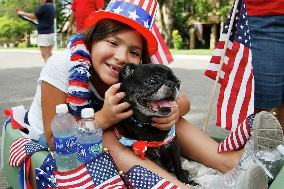 Seven-year-old Sarah Guerra and her dog Sushi get ready for a wagon ride in the Woodridge Independence Day celebration on July 2, 2011.  Photo by Marvin Pfeiffer Photo: Marvin Pfeiffer/Prime Time Newspapers