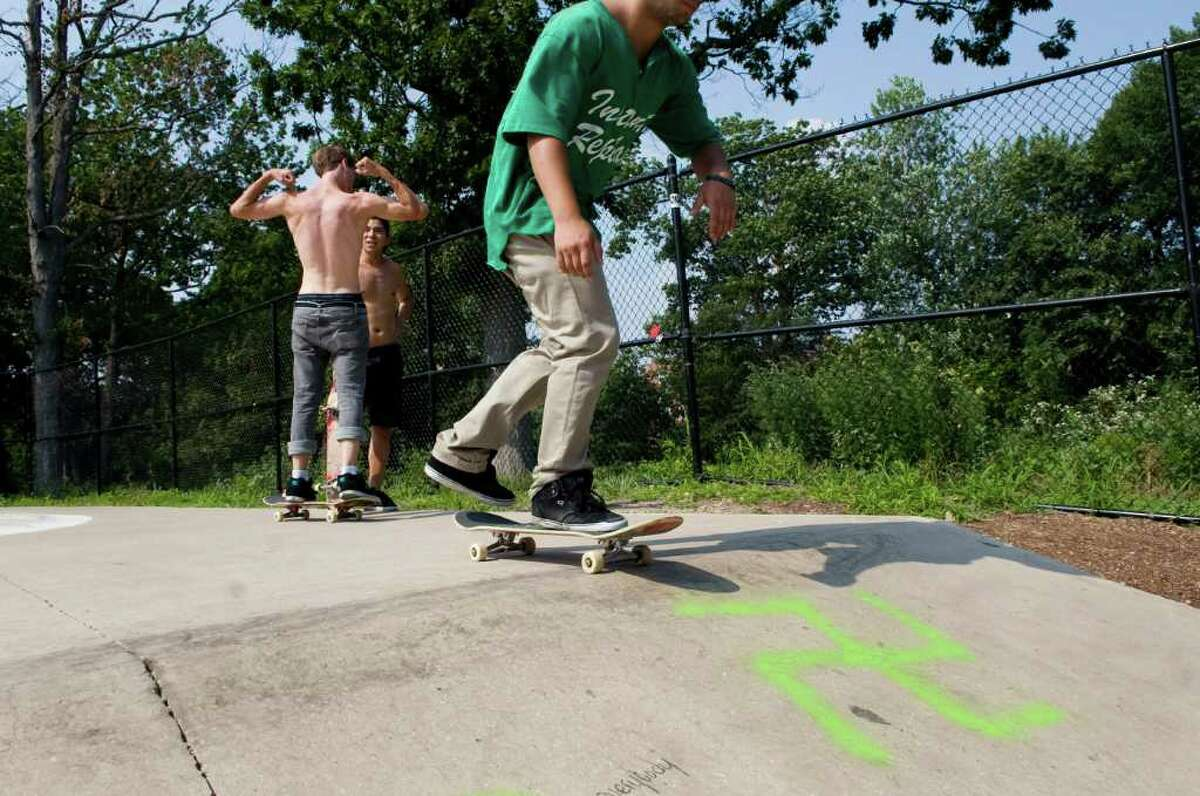 A group of teens skateboard in the skate park in Scalzi Park in Stamford, Conn. Wednesday July 6, 2011. The park was vandalized with swastikas and racist graffiti sometime in the past few weeks.