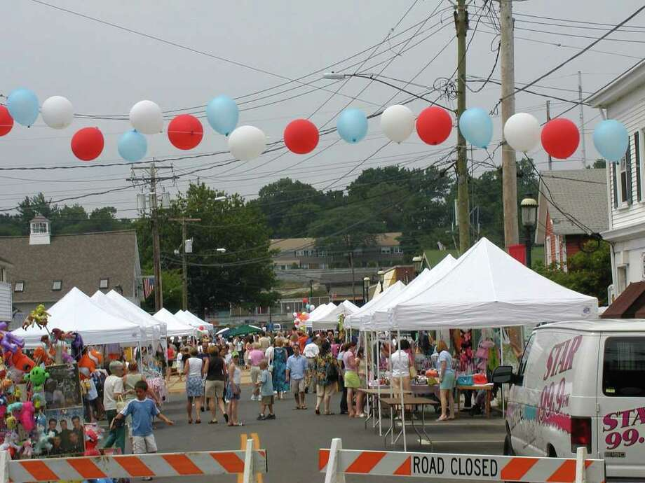 People enjoy the 10th annual Bastilles Day street fair in 2009. The event, which will take place Sunday, July 10, for the twelfth consecutive year, will feature French food, games and music in celebration of Bastilles Day. Photo: Contributed Photo