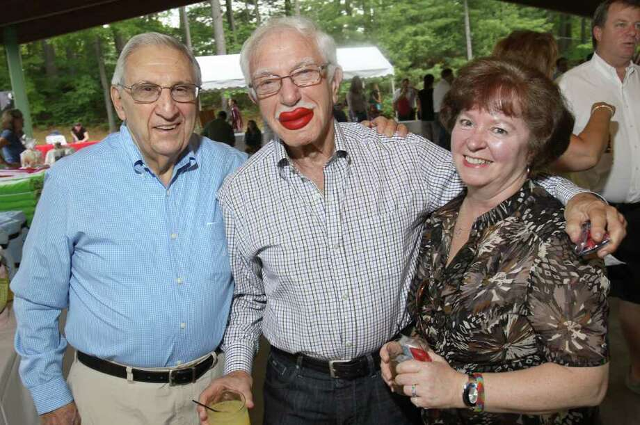 Lake George, NY - July 1, 2011 - (Photo by Joe Putrock/Special to the Times Union) - David Kaplansky(center) wears a pair of wax lips from the candy table with Norm Kudan(left) and Barbara Wilson(right) during the Double H Ranch 20th Anniversary Gala. Photo: Joe Putrock / Joe Putrock