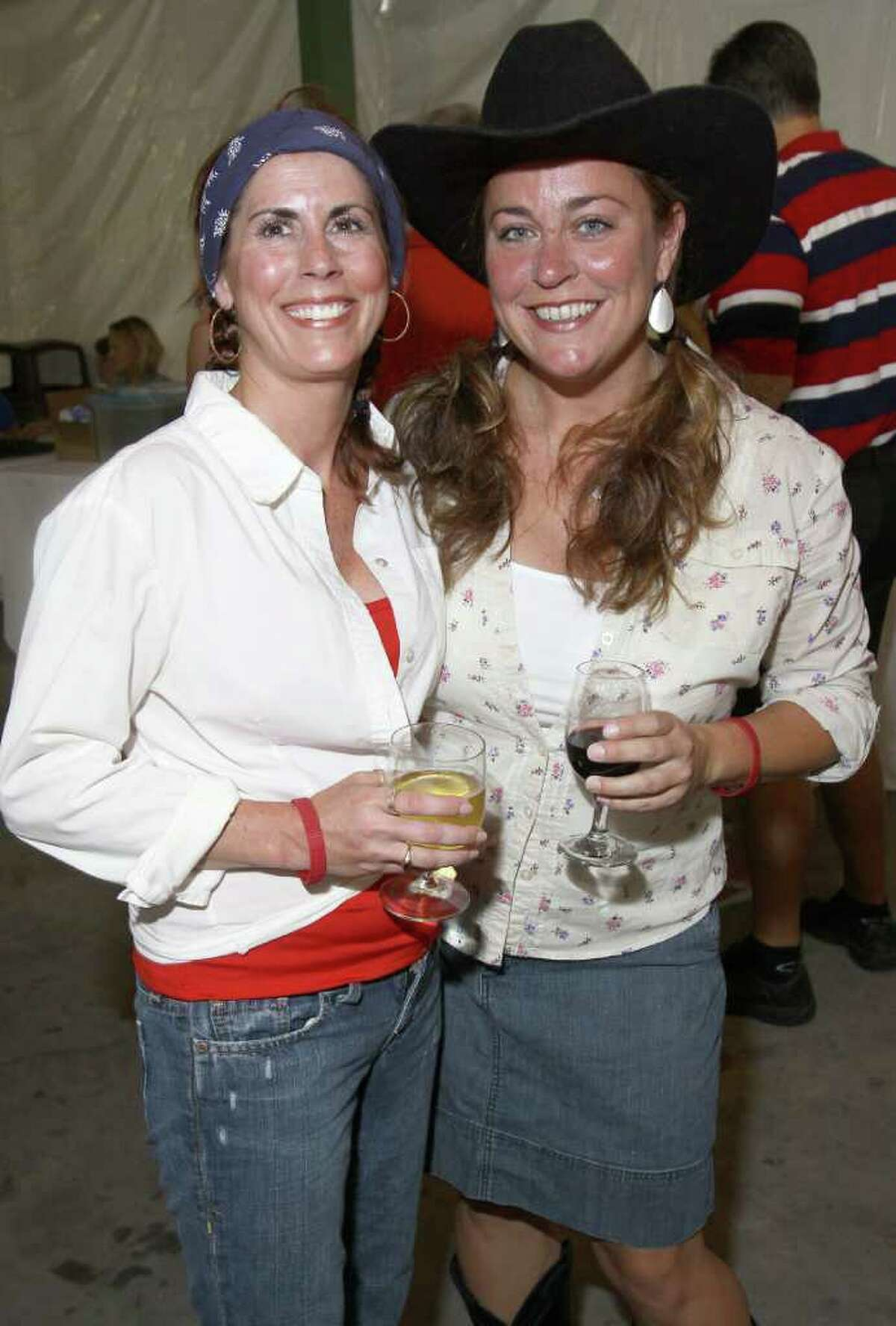 Lake George, NY - July 1, 2011 - (Photo by Joe Putrock/Special to the Times Union) - Samantha Corhouse(left) and Heather O'Neill(right) during the Double H Ranch 20th Anniversary Gala.