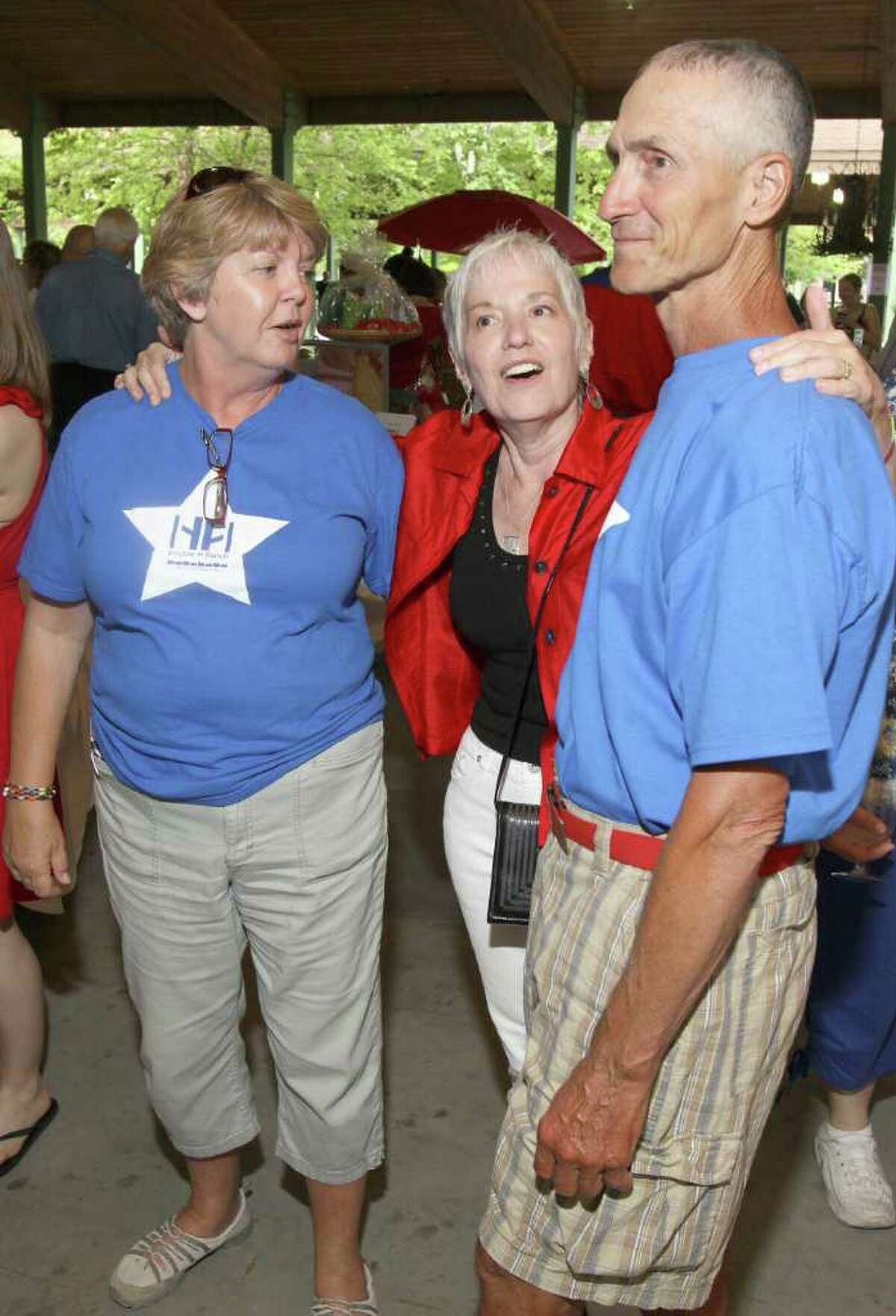 Lake George, NY - July 1, 2011 - (Photo by Joe Putrock/Special to the Times Union) - Double H Ranch board member Sandy Sherman(center) talks with volunteers Pat(left) and Dominick(right) Martino during the Double H Ranch 20th Anniversary Gala.