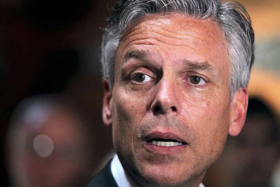 FILE - In this May 19, 2011 file photo, former Utah Gov. Jon Huntsman, Jr. speaks at a Meet and Greet in Hanover, N.H. For Republicans who once supported combating global warming, the race for the presidency is already getting hot  (AP Photo/Cheryl Senter, File) Photo: Cheryl Senter, FRE / FR62846 AP
