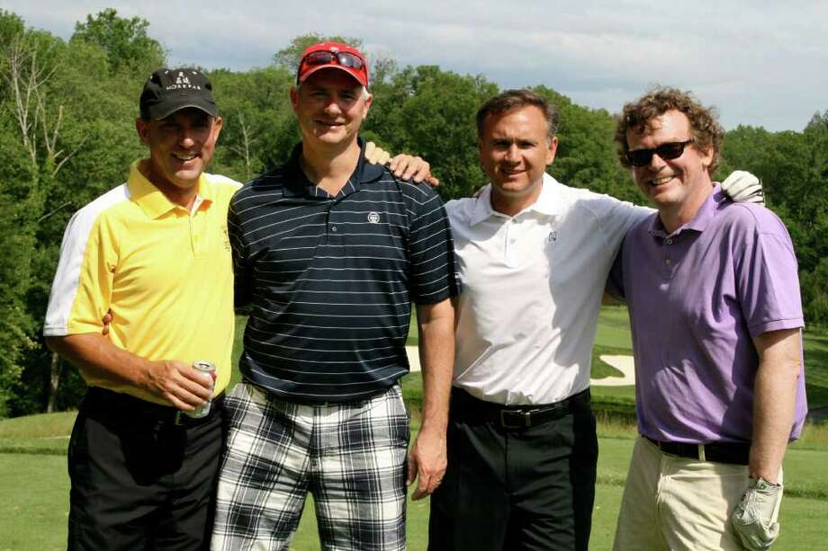 Getting together at the Fairfield Theater Company's third annual benefit golf tournament are, from left, Jamie Orviss, David Rush, Dave Montani and Russ Mitchell. The outing attracted the ebent's largest turnout. Photo: Contributed Photo / Fairfield Citizen contributed