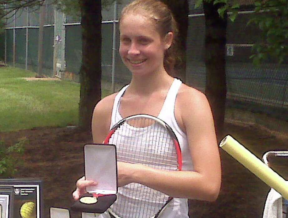 Weston's Kimmy Guerin revels in holding the gold medal Monday after winning the USTA U-16 National Open championship in Manasquan, N.J. Photo: Contributed Photo