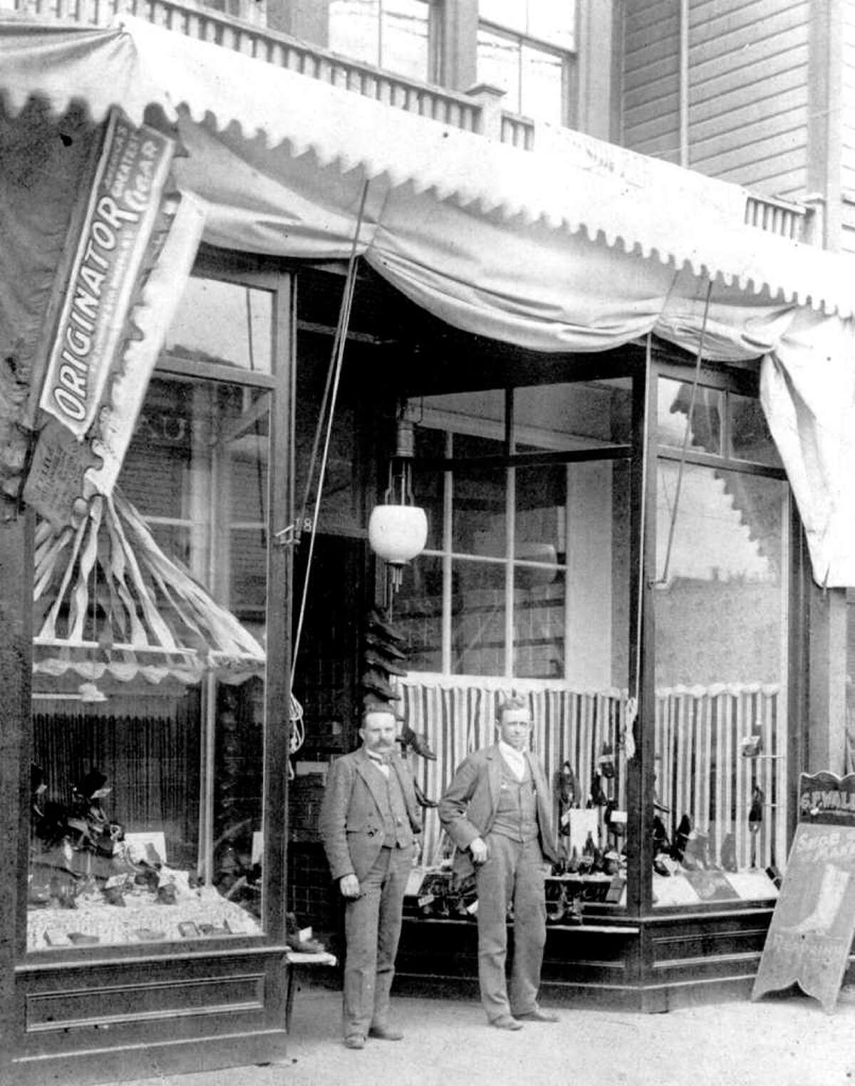 Carl Wallin, left, and John W. Nordstrom at their store near Fourth Avenue and Pike Street, 1901.
