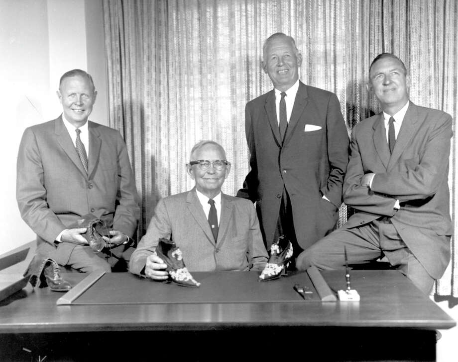 From left, Elmer, John, Everett and Lloyd Nordstrom in 1961. John holds an antique topper that was part of his 1901 stock. Photo: Seattlepi.com File