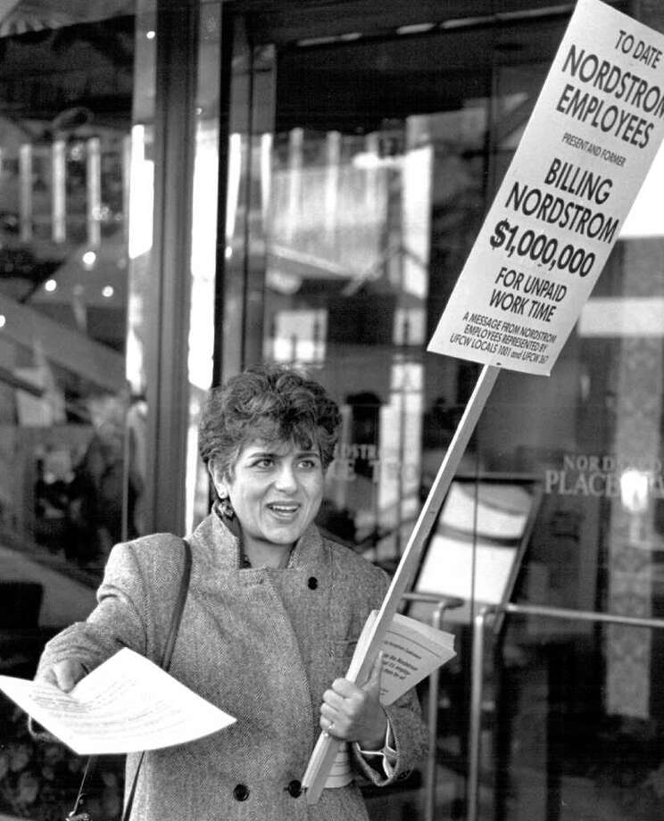 Elena Henry, of United Food and Commercial Workers, hands out material during informational picketing at Nordstrom Place Two on University Way, Nov. 30, 1989. Photo: Seattlepi.com File