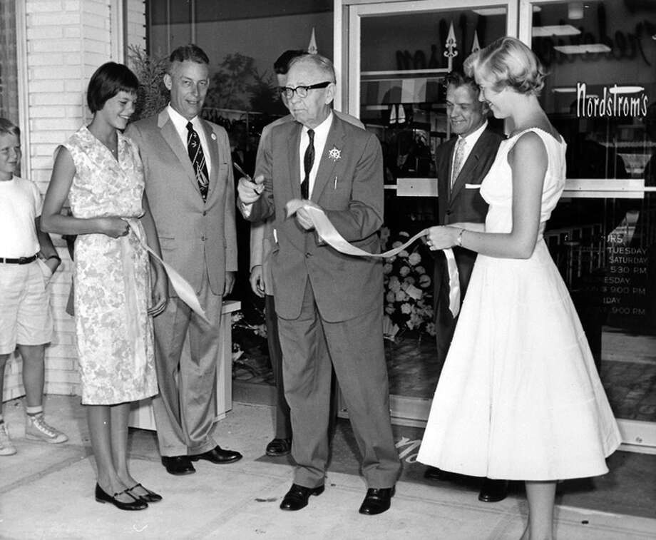 The opening of the Bellevue Square shoe store, 1958. With him are granddaughters Susan Nordstrom Eberhardt and Linda Nordstrom Mowat Photo: Seattlepi.com File