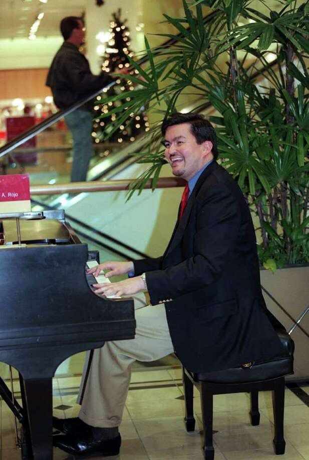 Joseph Rojo, pianist at Nordstrom, was in his 15th year playing at the store when the WTO riots occured. He said at the time it was difficult playing happy songs and Christmas songs knowing that just outside the door there was protesting. Photo: Seattlepi.com File