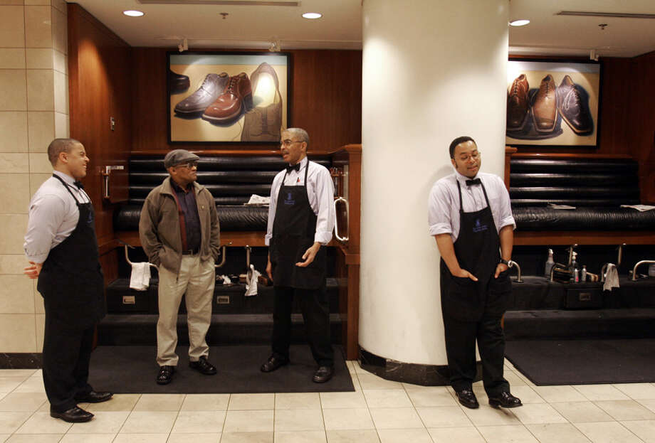 Morgan Perkins, center, speaks with Don Moore, while sons Brent, left, and Brian, wait for customers at the downtown Nordstrom on Aug. 16, 2007.